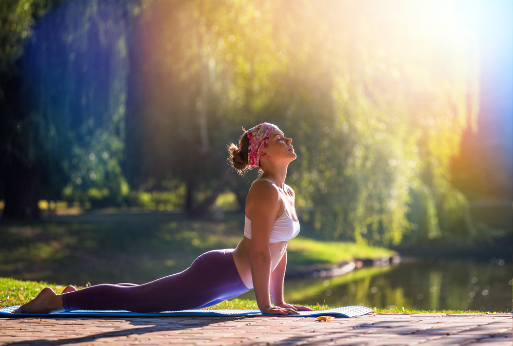 Woman Doing Yoga Serene Backdrop
