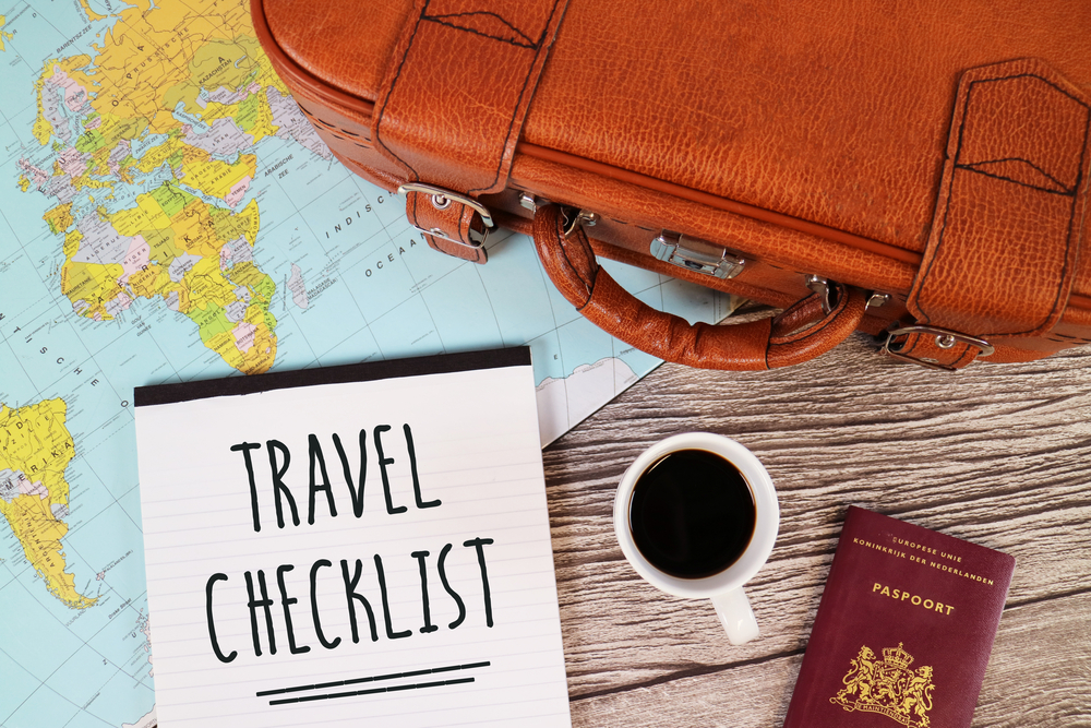 Travel Checklist with Bag, Passport, Map and Coffee Cup