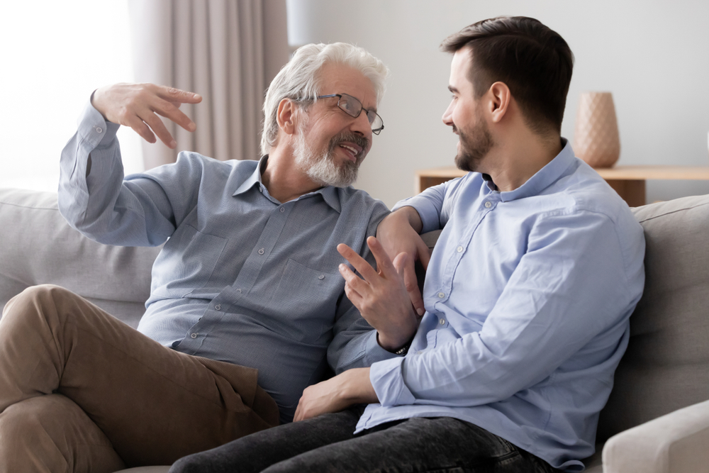 Father and Son Talking on Couch